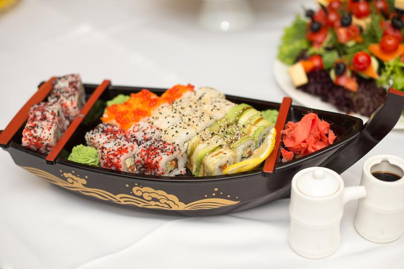 Various kind of sushi food served on boat capacity.Different Types of Maki Sushi and Nigiri Sushi. Various kind of sushi food served on boat capacity.Different royalty free stock photo