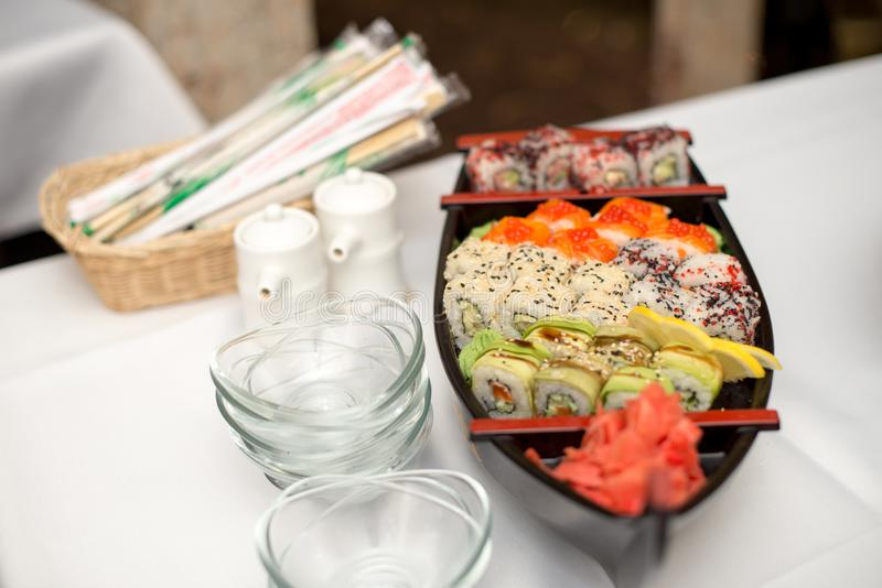 Various kind of sushi food served on boat capacity.Different Types of Maki Sushi and Nigiri Sushi. Various kind of sushi food served on boat capacity.Different stock photos