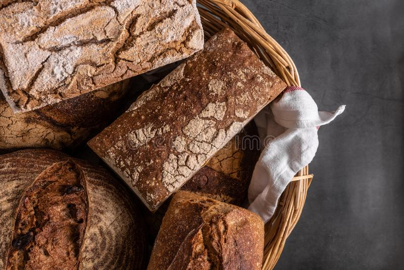 Fresh sourdough bread. Various kinds of Artisan fresh sourdough bread on wooden table background royalty free stock photography