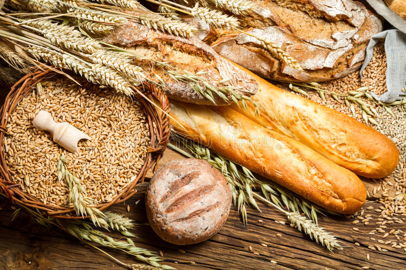 Various kinds of fresh baked bread with grain royalty free stock image