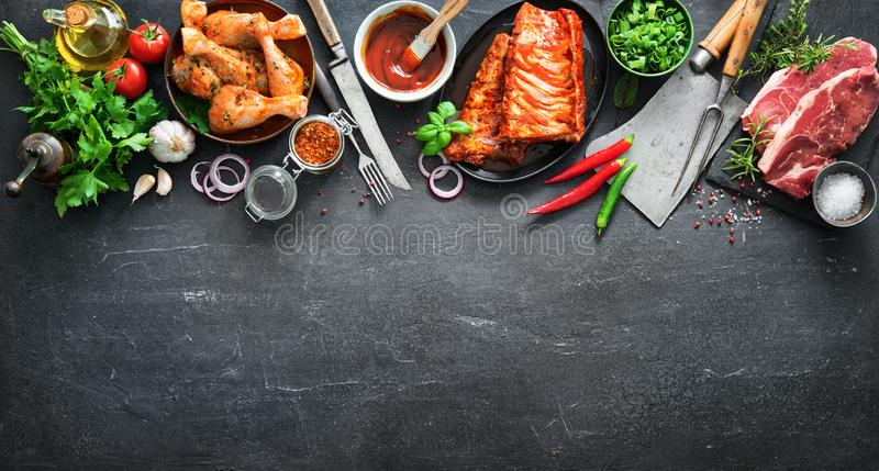 Various kinds of grill and bbq meats with vintage kitchen and butcher utensils stock images