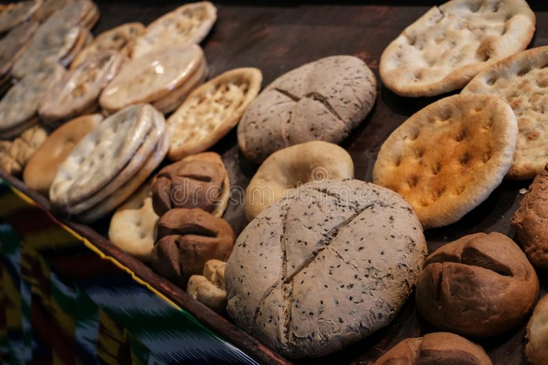 Various kinds of Naan. Famous homemade bread originated from Muslim country. Assorts fresh home made bread on wooden table under stock photos