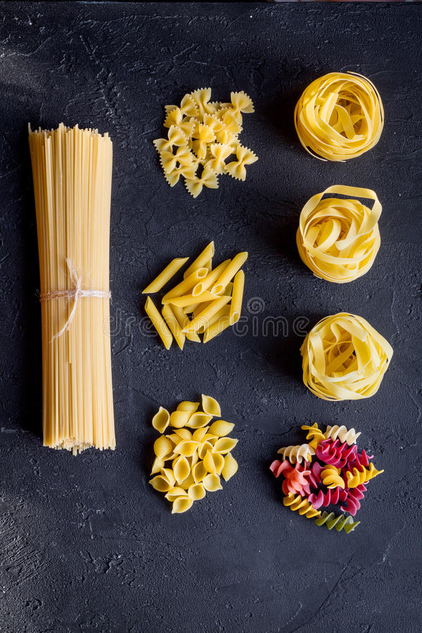 Various kinds of paste on dark background top view.  stock photography