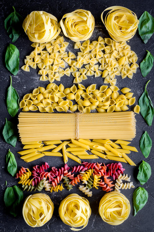 Various kinds of paste on dark background top view.  stock images