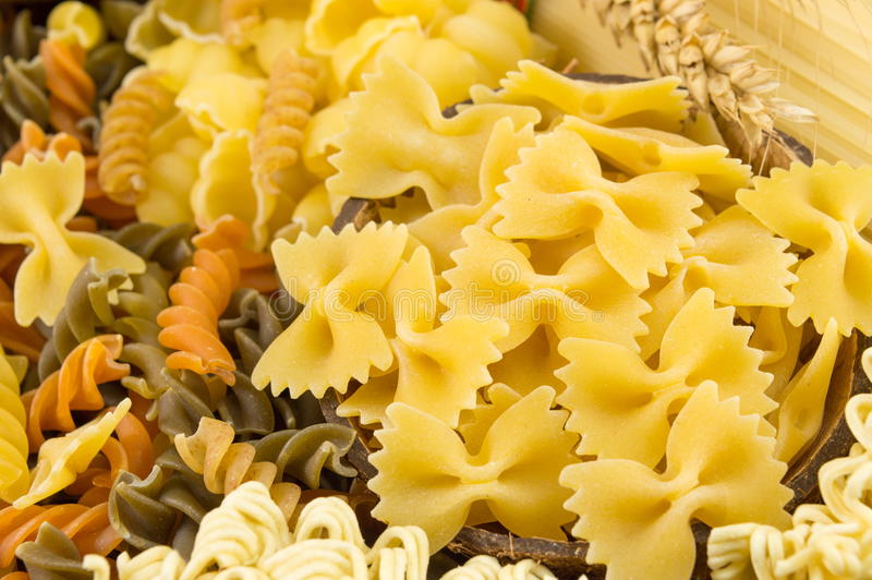 Various kinds of uncooked pasta. Different types of uncooked pasta on a pile stock image