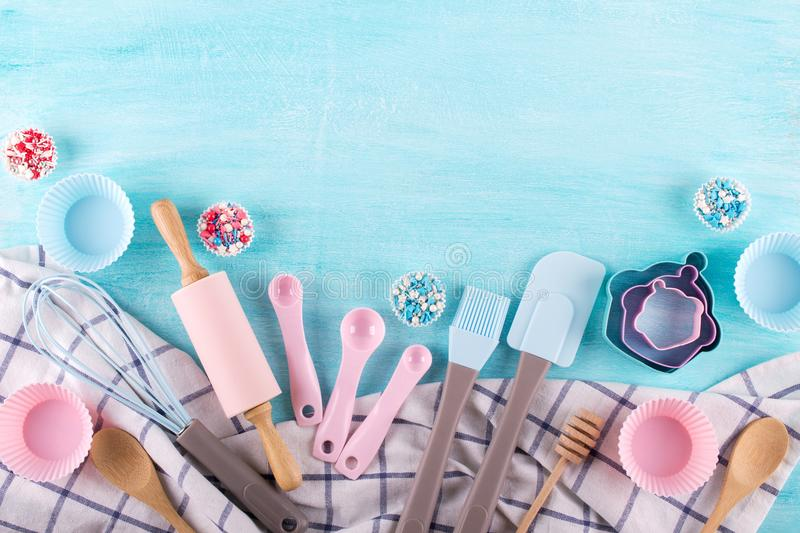 Various kitchen baking utensils. Flat lay. Mockup for recipe on blue background. royalty free stock image