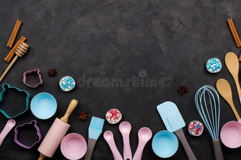 Various kitchen baking utensils. Flat lay. mockup for recipe on dark background. stock image