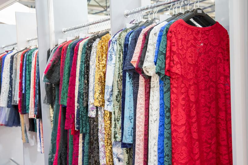Various lace dresses in the store stock photography