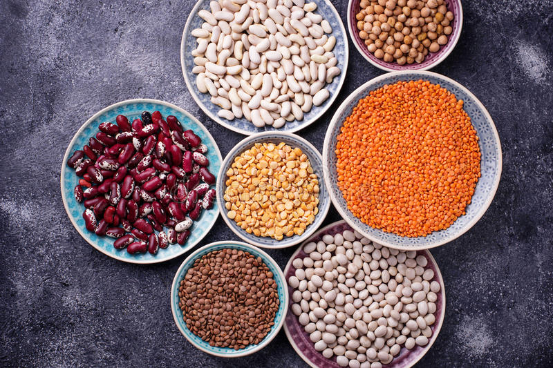 Various legumes. Chickpeas, red lentils, black lentils, yellow p. Eas and beans. Selective focus. Top view stock photo