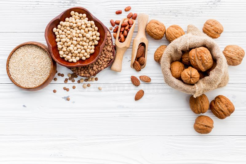 Various legumes and different kinds of nuts set up on wooden table royalty free stock photos