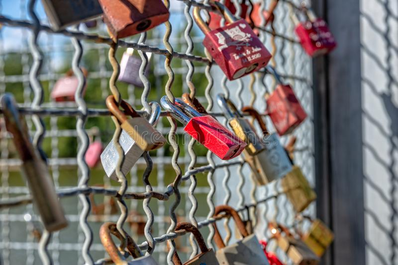 Various locks with names on a metal grid. Some and Various locks with names on a metal grid royalty free stock photo