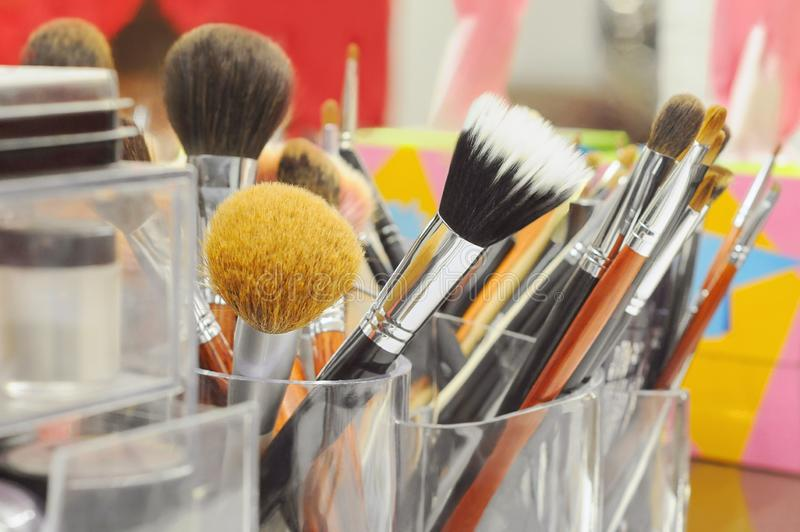 Various makeup brushes and tools on color background stock photos