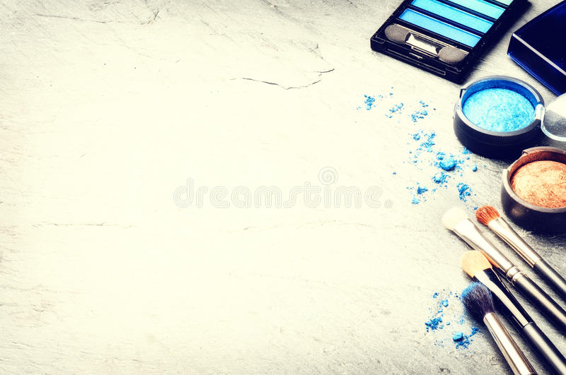 Various makeup products in blue tone stock image
