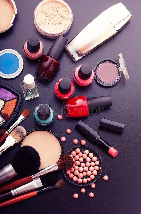 Various makeup products on dark black background with copyspace stock images