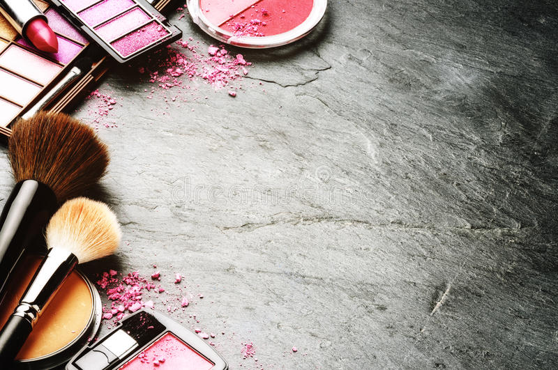 Various makeup products in pink tone royalty free stock image