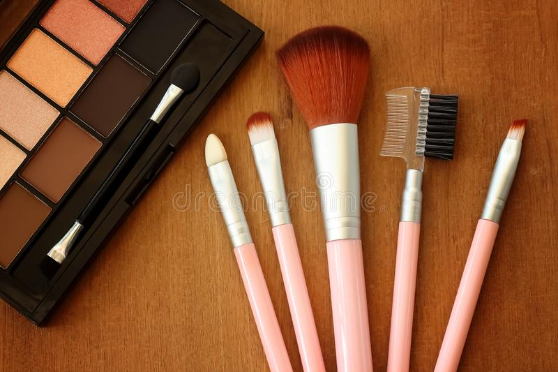 Various makeup products on plywood background. stock images