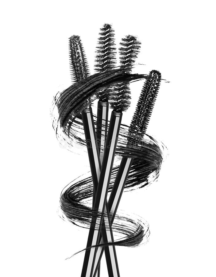 Various mascara brushes wrapped in a smear stock photo