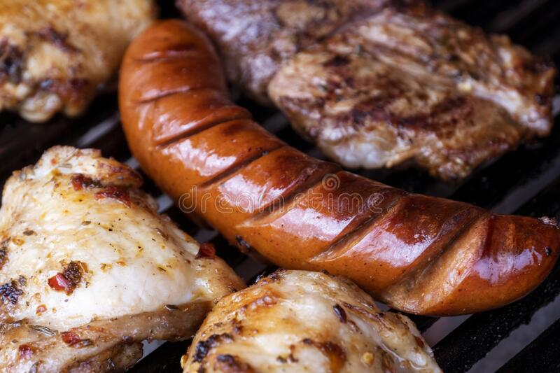 Various meat on the barbecue royalty free stock photography