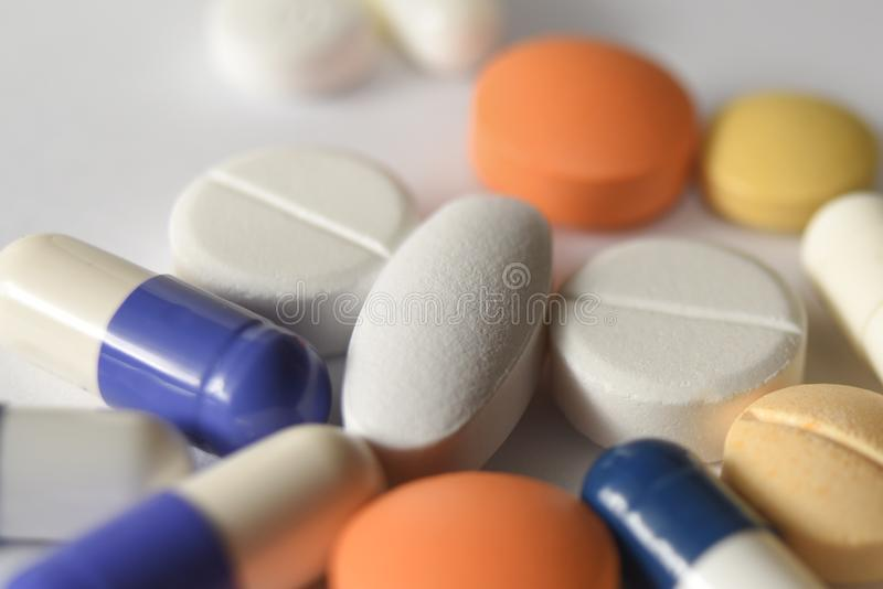 Various Medical pills and capsules stock photos