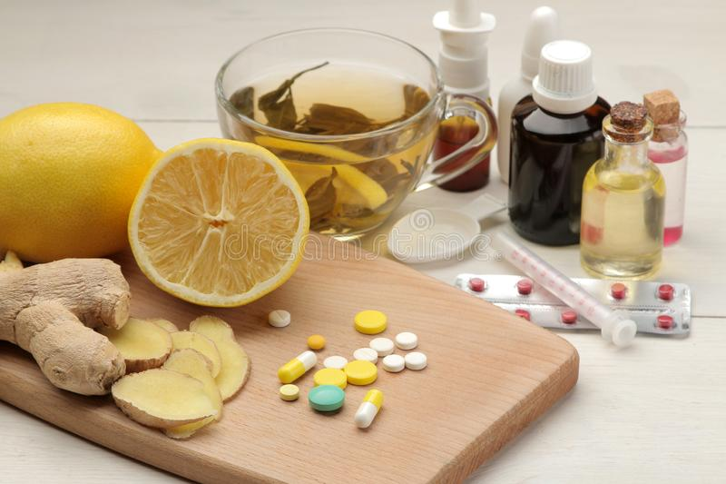 Various medicines for flu and cold remedies on a white wooden table .. Cold. diseases. cold. flu royalty free stock image