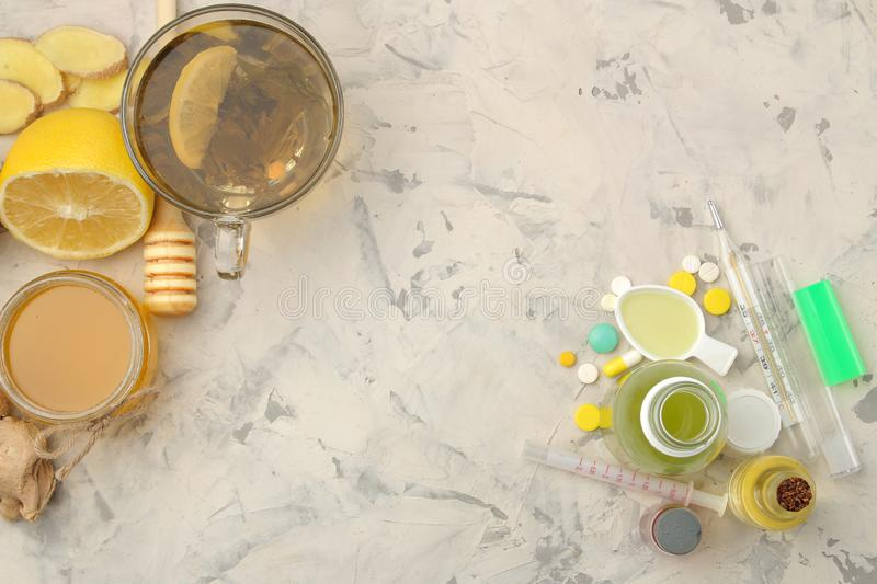 various medicines for flu and cold remedies on a white wooden table .. Cold. diseases. cold. flu. view from above stock photos