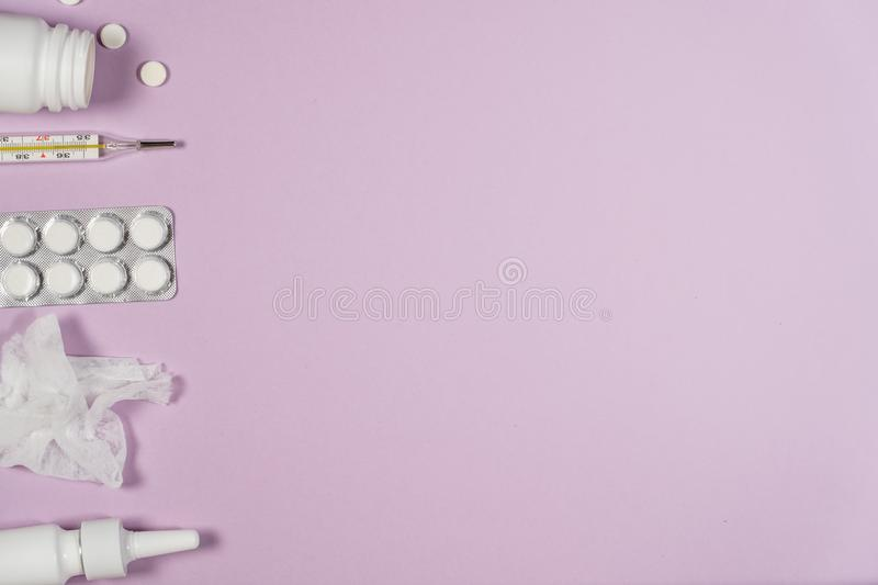 Various medicines, a thermometer, sprays from a stuffy nose and royalty free stock photography