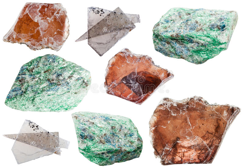Various mica mineral rock stones isolated on white. Natural mineral gemstones - various mica (muscovite) mineral rock stones isolated on white background royalty free stock images