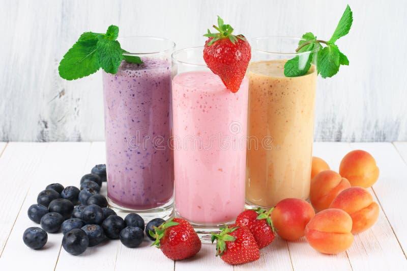 Various milkshakes with fruits stock photo