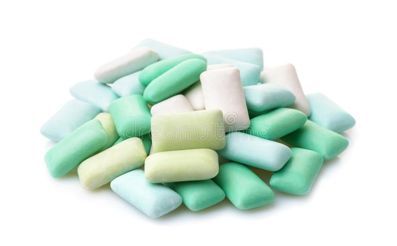 Various mint chewing gum pieces. Pile of various sugar free mint chewing gum pieces isolated on white stock images