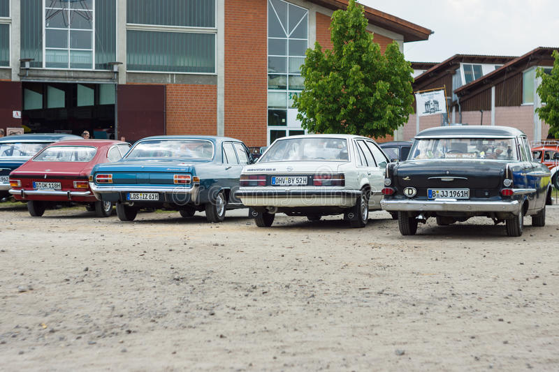 Various models of the Opel stand in a row. PAAREN IM GLIEN, GERMANY - MAY 23, 2015: Various models of the Opel stand in a row. Rear view. The oldtimer show in stock photo