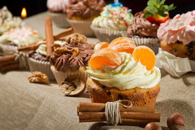 Various muffin with cream and nuts royalty free stock photos