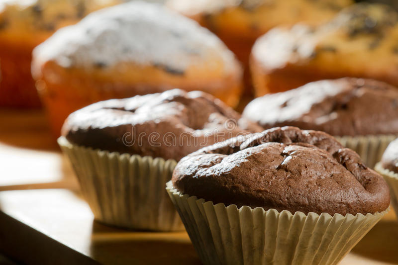 Various muffin on wooden board stock photos