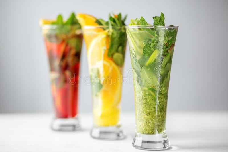 Various non-alcoholic cocktails with fruit and mint. Concept for drinks, summer, heat, alcohol, party and bar royalty free stock photography
