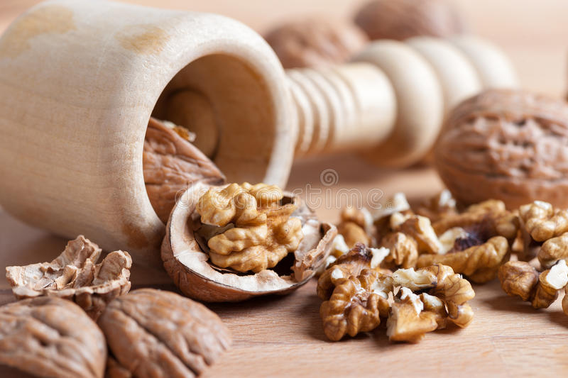 Various nuts with a broken shell on rustic wood. Nuts still life with a broken shell in the foreground stock photography