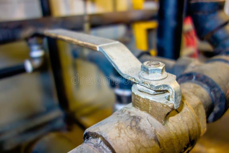 Various old boiler room pipe valves stock photo