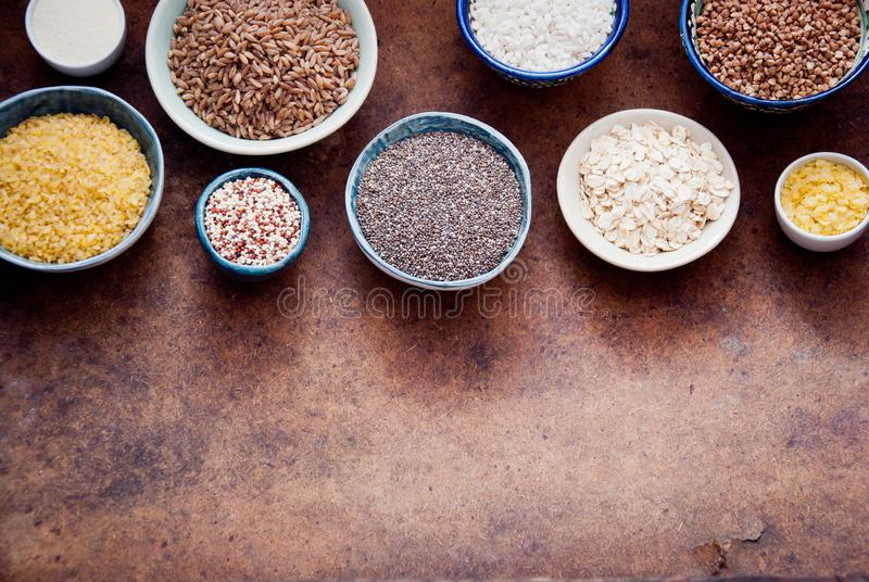 Various organic cereals and grains in different bowls royalty free stock images
