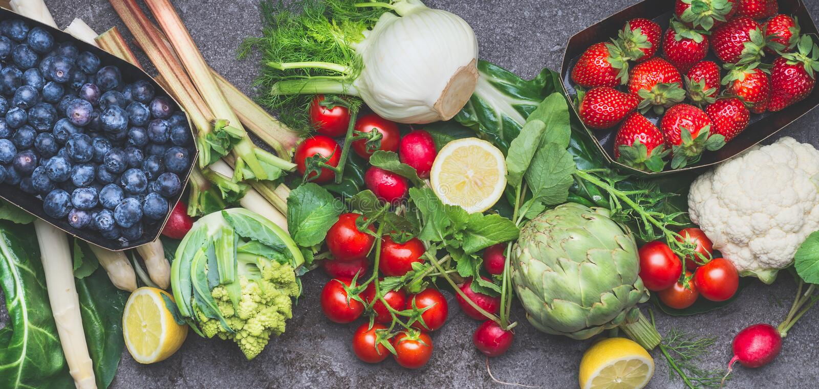 Various organic vegetables, fruits and berries for healthy, clean , vegetarian or diet eating stock images