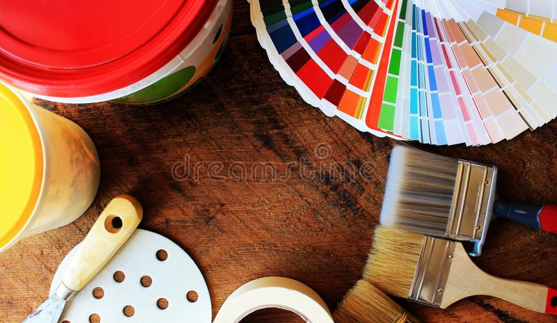 Various painting tools and color palette. On wooden background stock photography