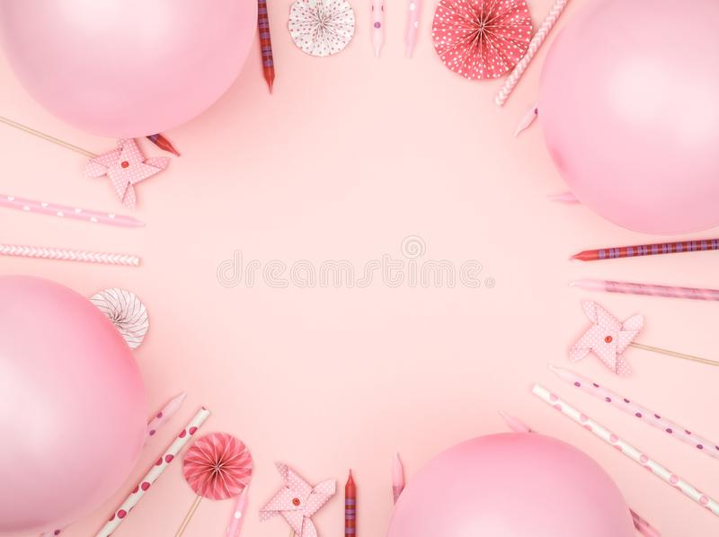 Various party confetti and balloons on colorful background with border stock photography