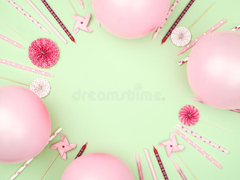 Various party confetti and balloons on colorful background with border. Flat lay. Celebration pattern royalty free stock photography