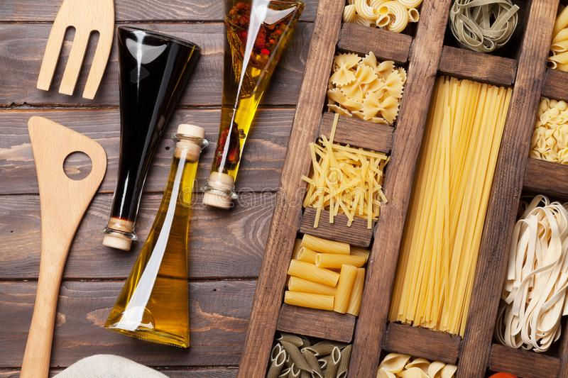 Various pasta and condiments stock photo