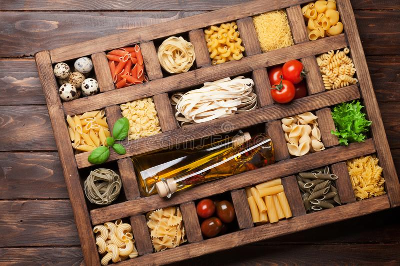 Various pasta in wooden box royalty free stock images