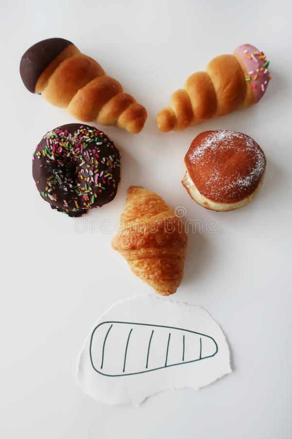 Various pastries grimacing stock images