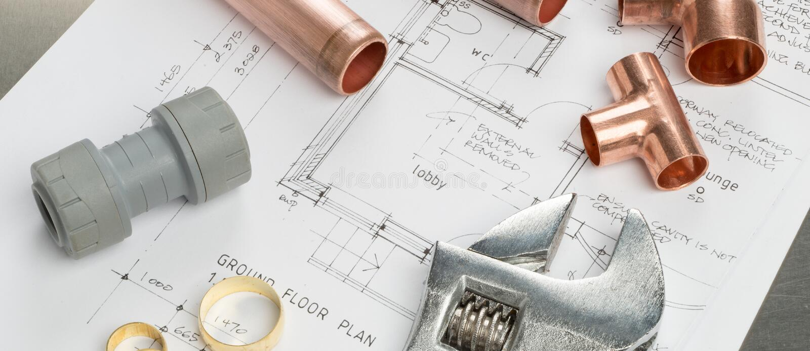 Various Plumbers Tools and Plumbing Materials on Architectural P stock photography