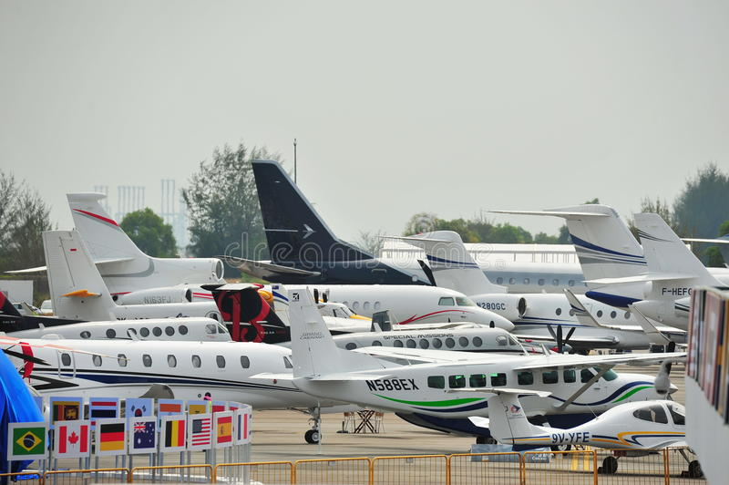 Various private and business jets on display at Singapore Airshow stock image