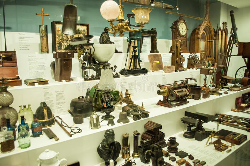 Various retro objects displayed in showcases in London Science Museum royalty free stock photo