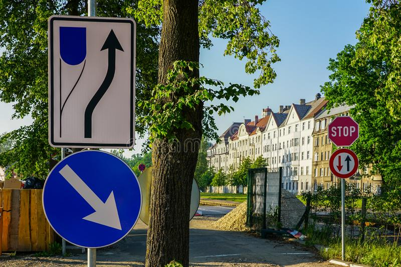 Various road signs for optimal traffic organization. In city stock photography
