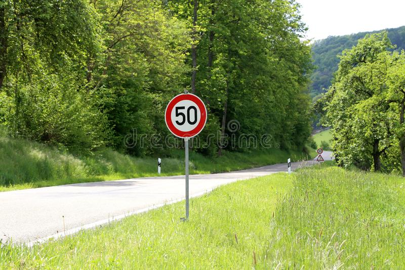Various road signs on the road warn of danger.  stock photo