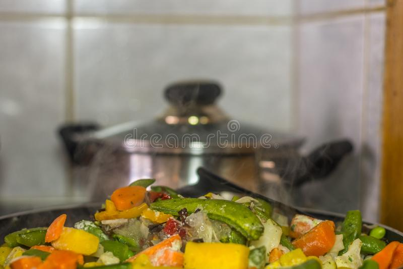 Various roasted vegetables with smoke. In the kitchen, broccoli, eat, diets, green, white, component, raw, freshness, foods, vegetarian, healthful, vitamins royalty free stock photo