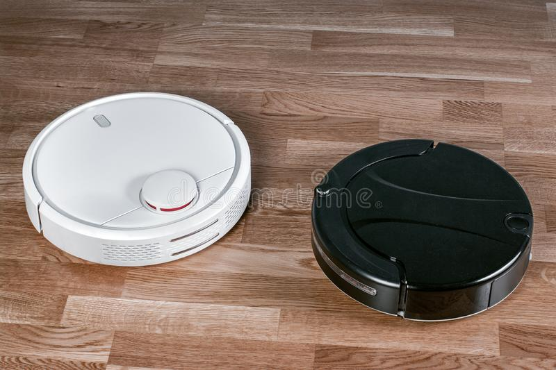Various robotic vacuum cleaners, effective dust absorption in the absence of the householder, modern smart home cleaning device.  stock image